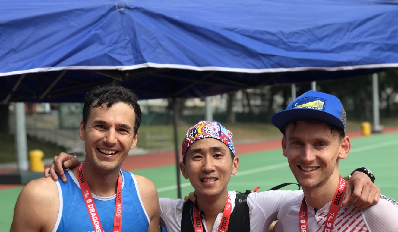 Deng Goumin flanked by Harry Jones (right) and Michael Skobierski after the 9 Dragons 50 mile 2018. Photo: Handout
