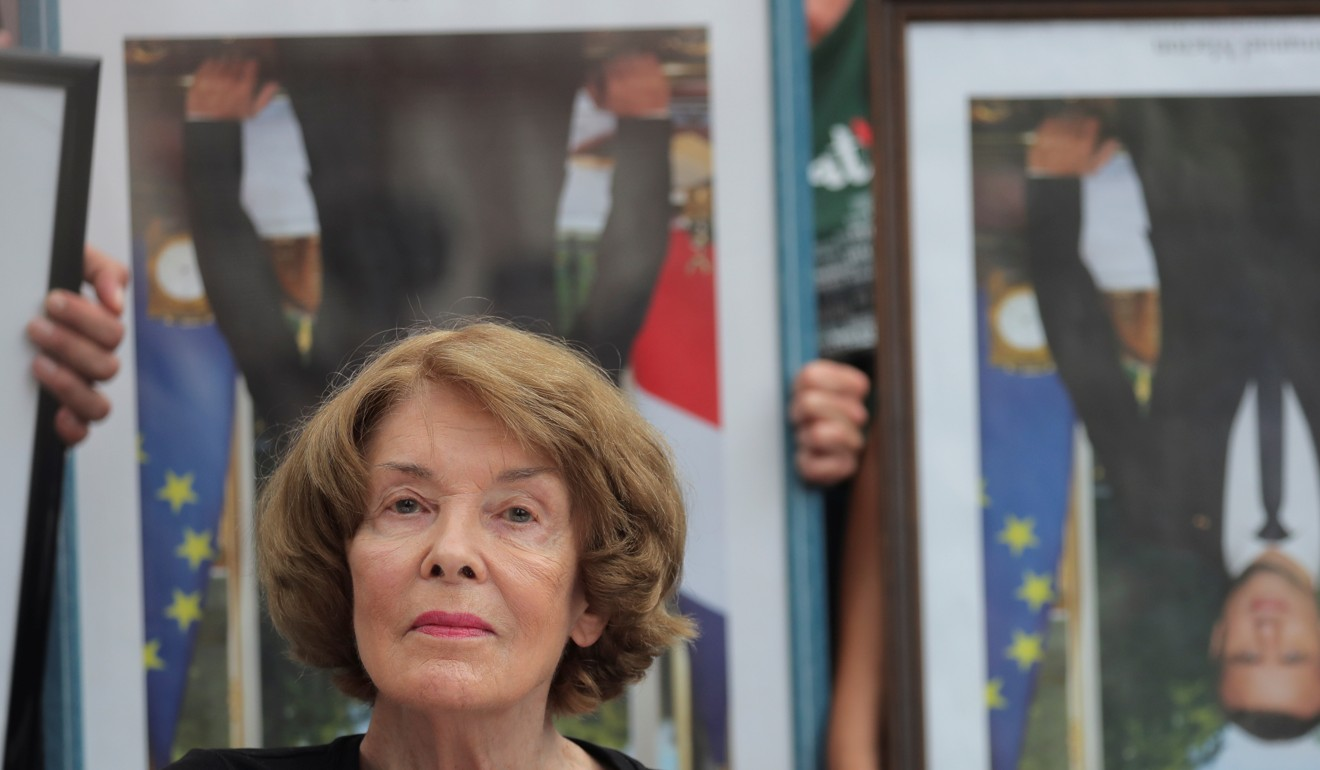 Hundreds of anti-G7 activists stage protest march with 'stolen' portraits of French President Emmanuel Macron