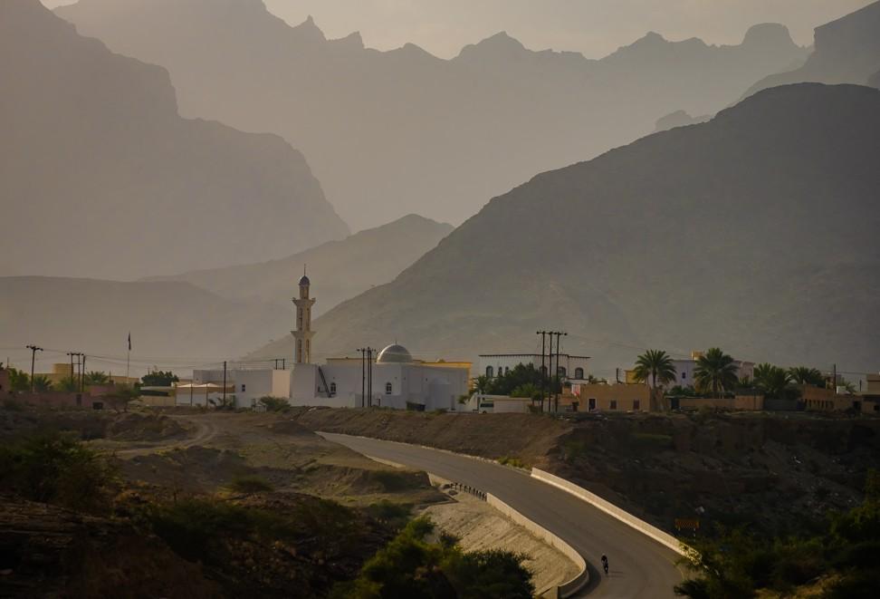 A rider makes their way through the mountains of Oman during Bikingman.