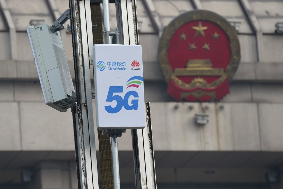 A 5G mobile base station with logos of China Mobile and Huawei Technologies is seen in Luoyang, a city in central China's Henan province, on February 27. Photo: Reuters