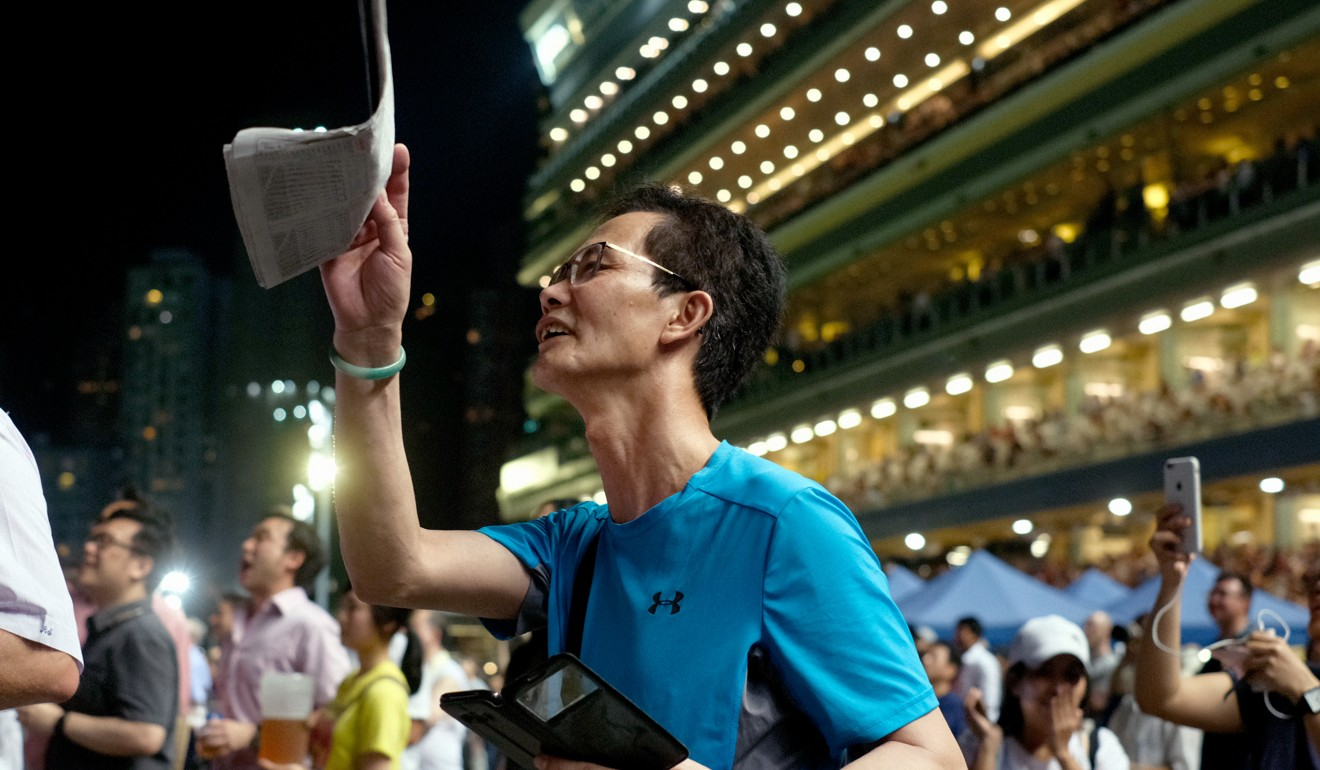 A punter cheers home his horse at Happy Valley. Photo: SCMP
