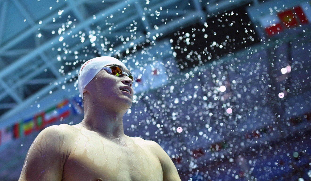 Sun Yang questioned by fans for missing China swimming team's military training camp in Beijing