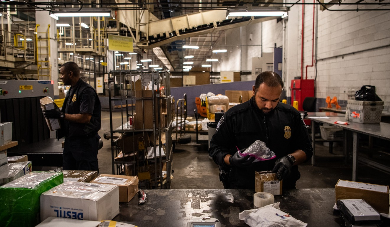 Customs officials check items of mail for illegal drugs at John F. Kennedy International Airport in New York. Photo: Washington Post