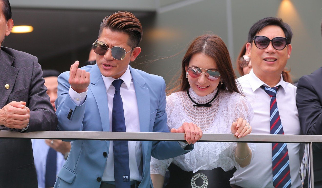 Super star Aaron Kwok watches his horse Dancing Fighter run second at Sha Tin.