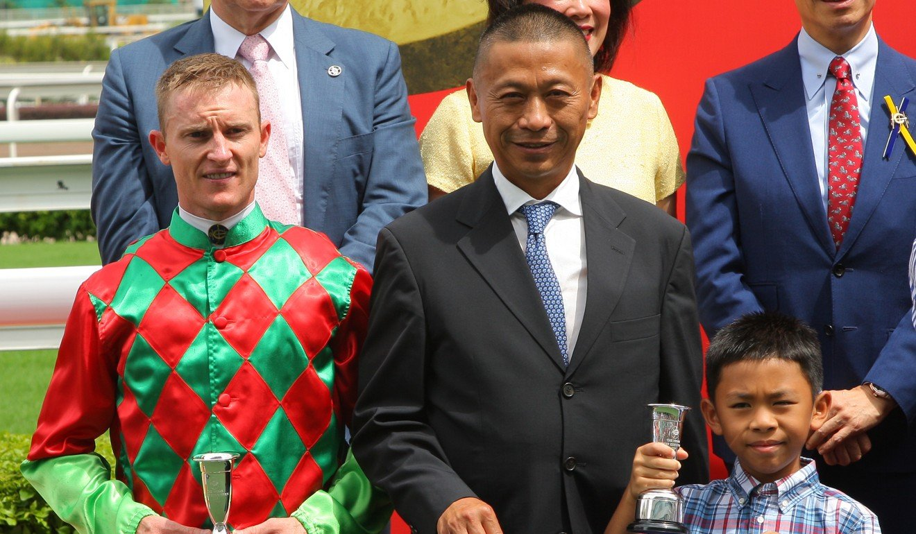 Trainer Danny Shum and jockey Zac Purton celebrate an opening-day double.