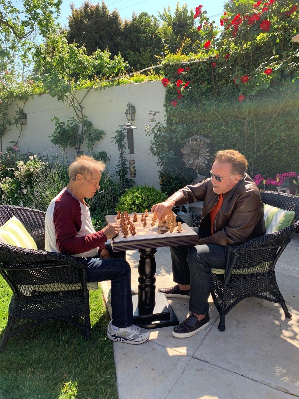 Arnold and Franco play chess. Photo: Instagram