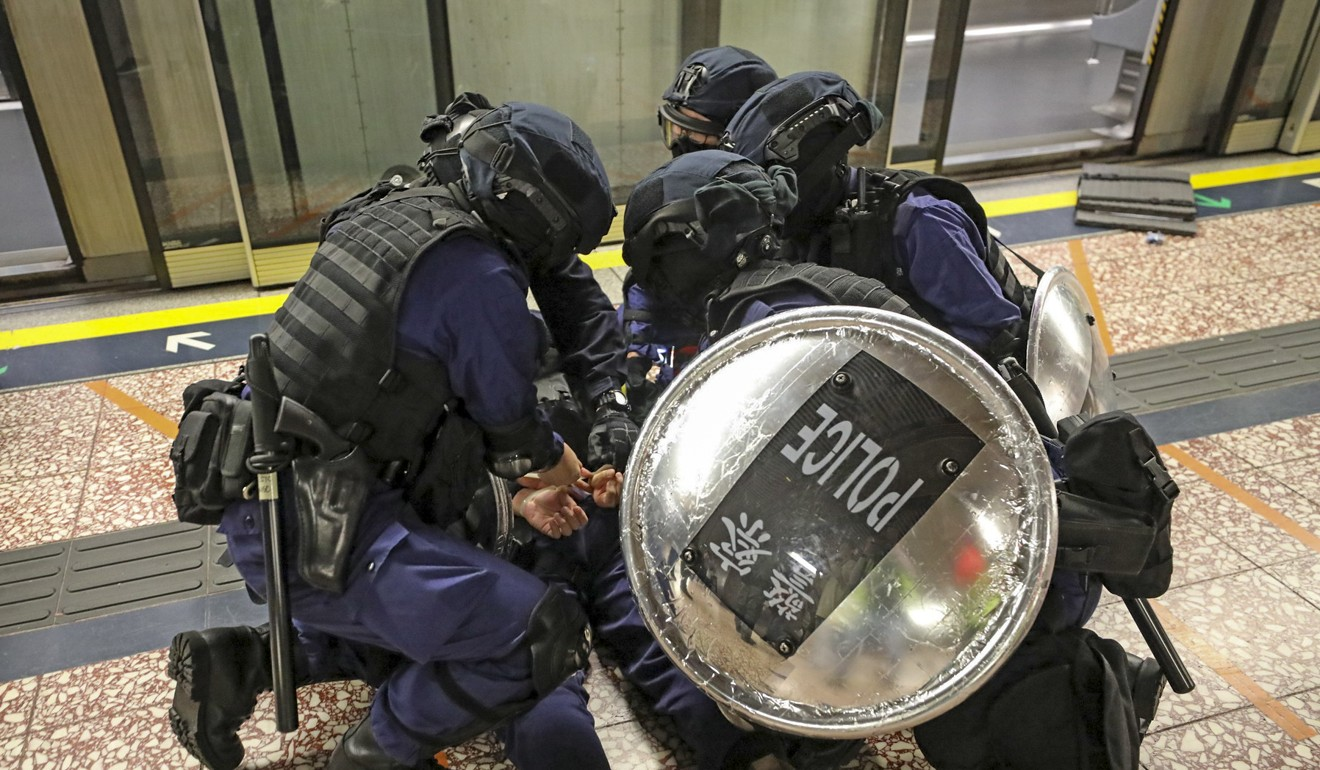 Riot police arrest an anti-government protester in Prince Edward MTR Station. Photo: Handout