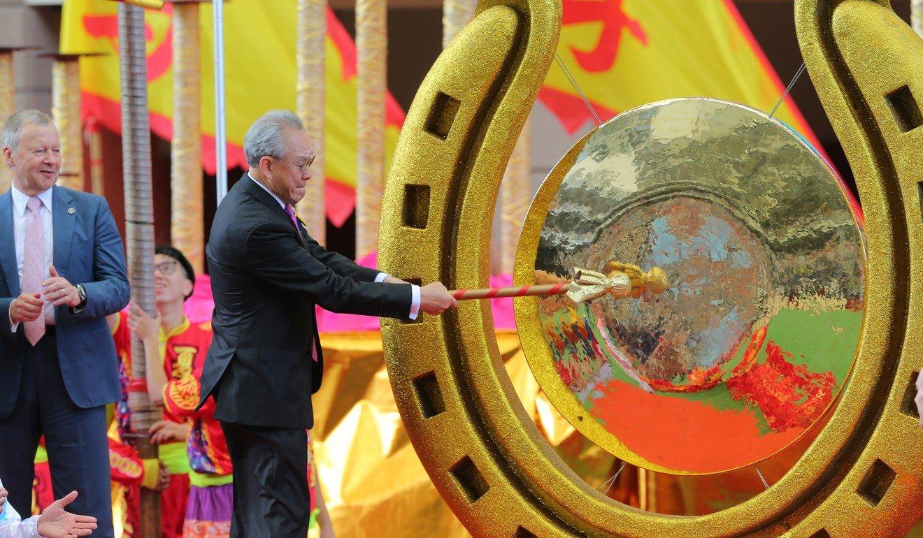 Jockey Club chairman Anthony Chow opens the racing season by striking a gong.