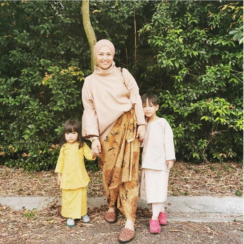 Fashion designer Helina Mohd Noor wearing a hijab in the turban style with two of her children.