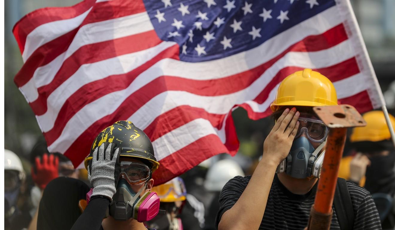 The US flag flies at an anti-government protest in Hong Kong. Photo: Sam Tsang