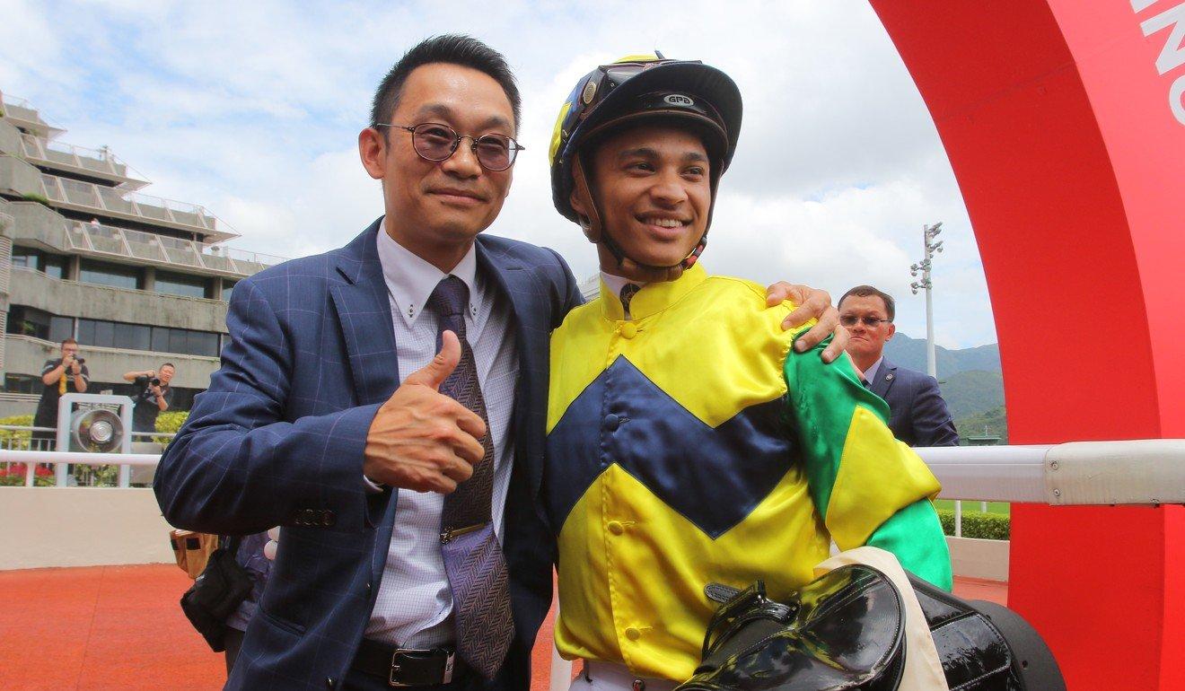 Jockey Grant van Niekerk and trainer Jimmy Ting celebrate their maiden Hong Kong victories.
