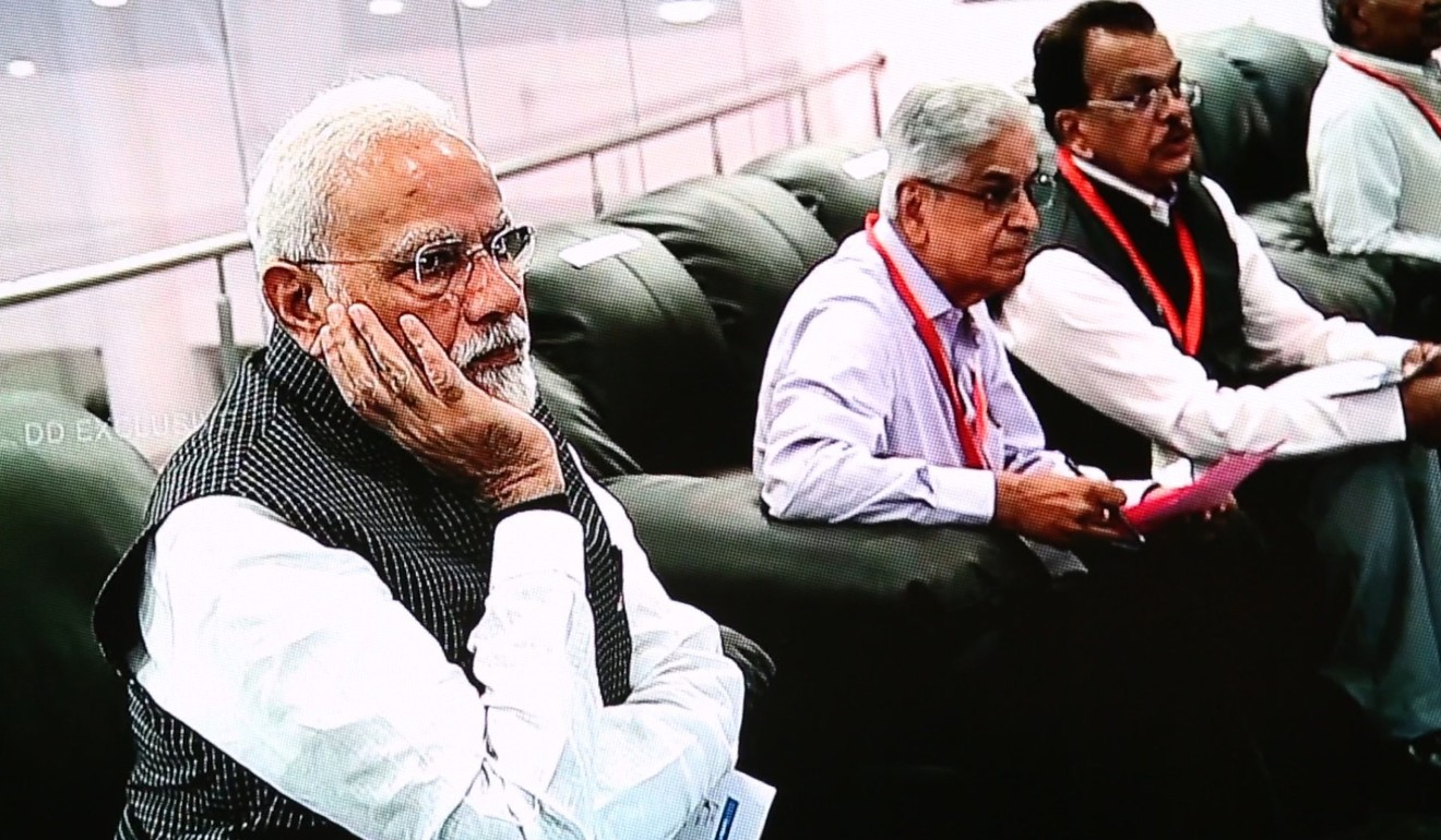 Indian Prime Minister Narendra Modi (left) reacts at the Indian Space Research Organisation ground station after news that communication with the Vikram landing had been lost on Saturday. Photo: EPA-EFE