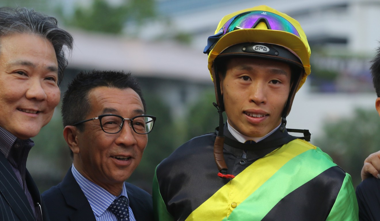 Me Tsui and Vincent Ho celebrate one of Ugly Warrior's victories at Sha Tin.