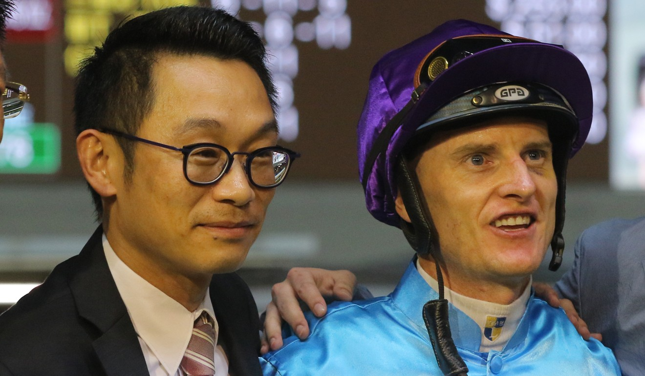Trainer Jimmy Ting and jockey Zac Purton celebrate Yee Cheong Baby's most recent victory.