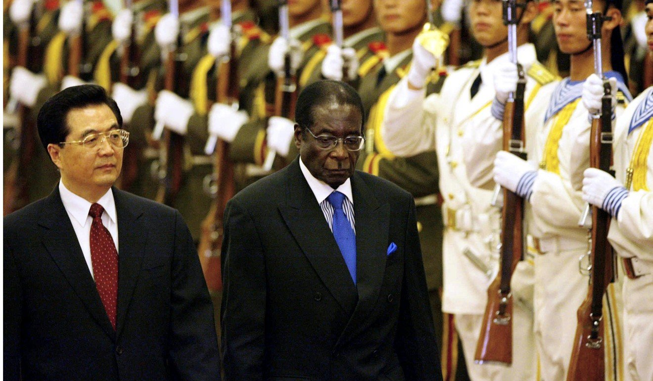 Robert Mugabe attends a welcome ceremony at the Great Hall of the People in Beijing with former Chinese president Hu Jintao in 2005. Photo: AFP
