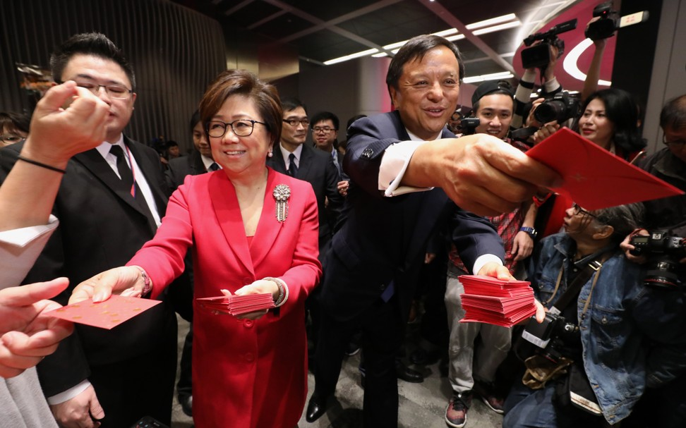 Hong Kong Exchanges and Clearing (HKEX) Chairwoman Laura Cha Shih May-lung, and Chief Executive Officer Charles Li Xiaojia handing out lai see red packets during the first trading day of the 2019 Lunar New Year in Hong Kong on 8 February 2019. Photo: Felix Wong