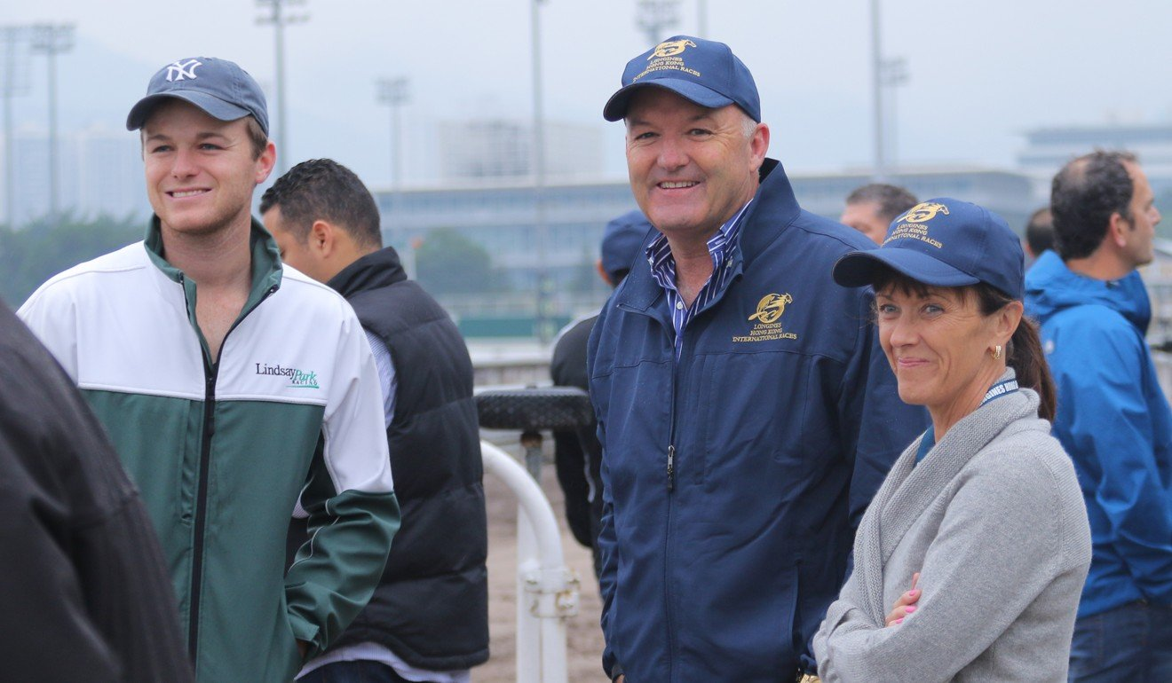 Trainer David Hayes (middle) with his son Ben and wife Prue at Sha Tin trackwork in 2015.