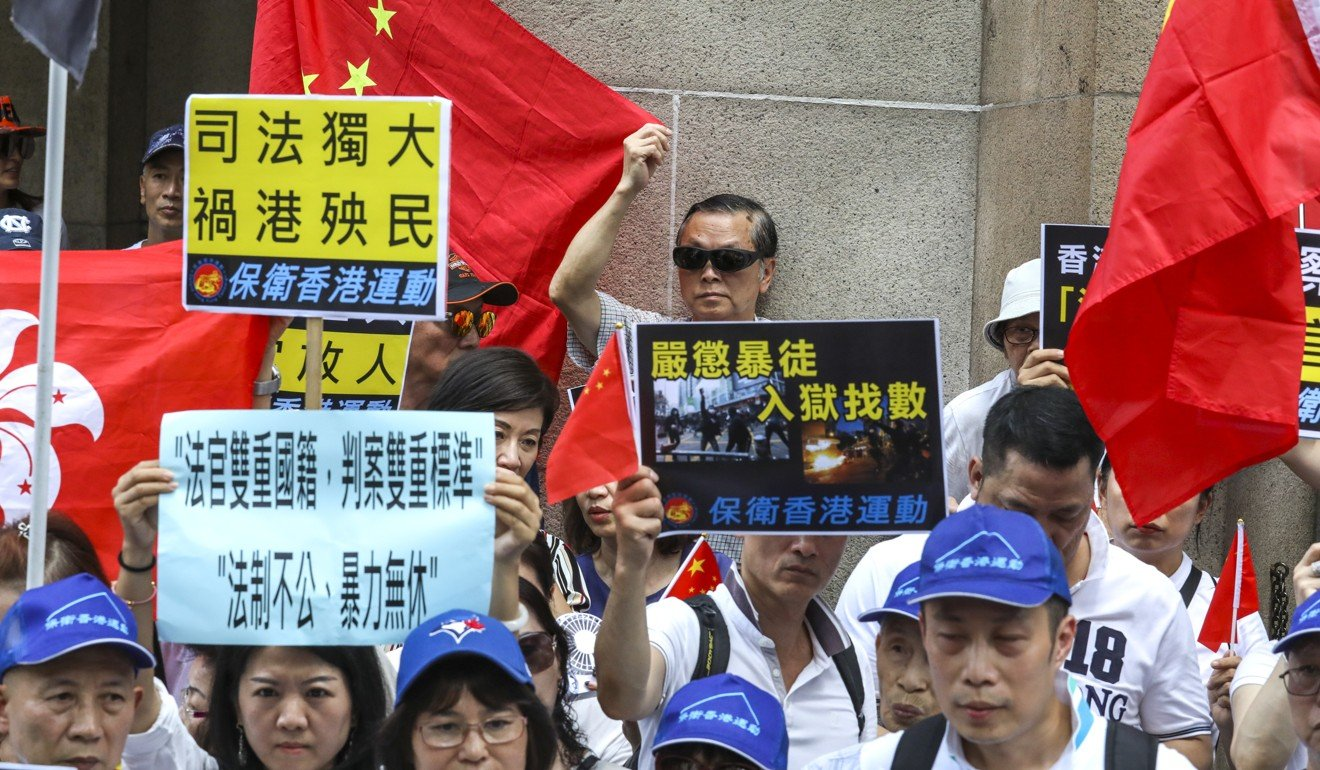 Pro-government demonstrators demand resignation of Hong Kong Chief Justice Geoffrey Ma over 'lenience' shown to democracy activists