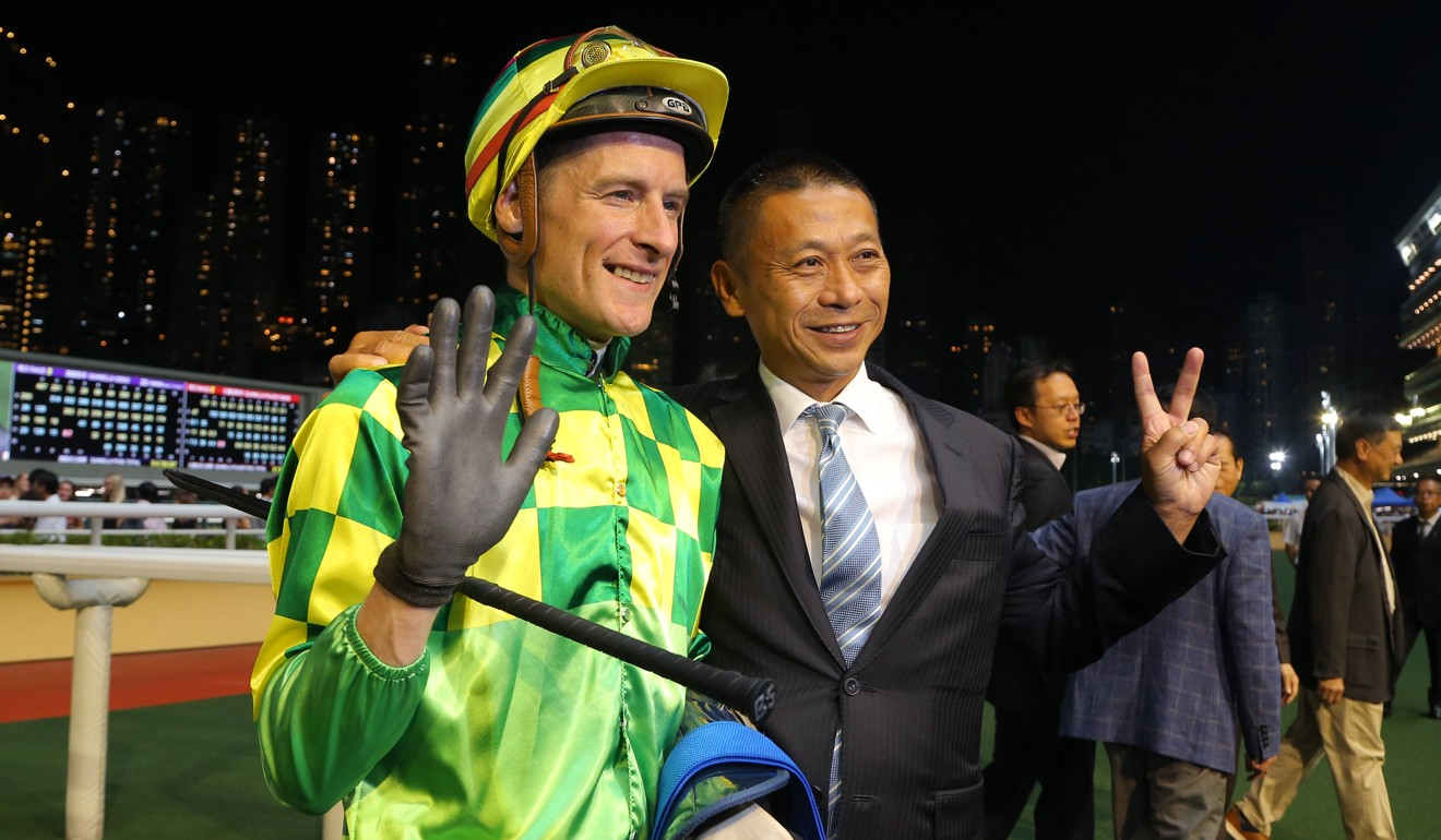 Blake Shinn and Danny Shum celebrate Green Dispatch's win.