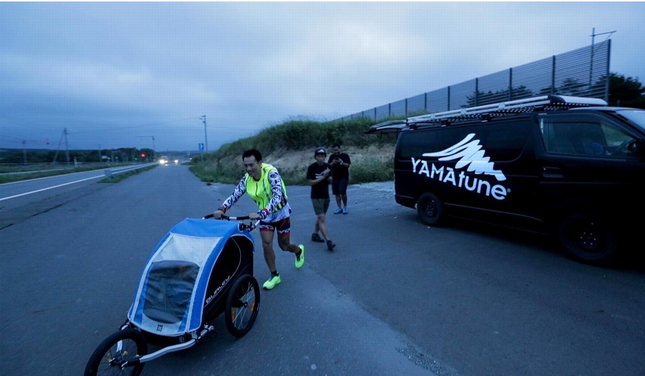 Wong Ho-fai has friends join him for support as he runs the length of Japan, but is also often alone. Photo: Handout
