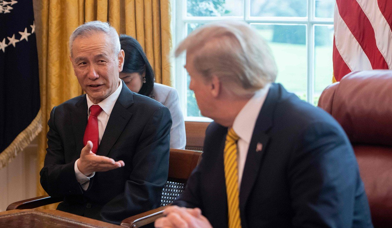 China's Vice-Premier Liu He, shown with Trump on April 4, has indicated a willingness to achieve some sort of interim trade deal. Photo: AFP