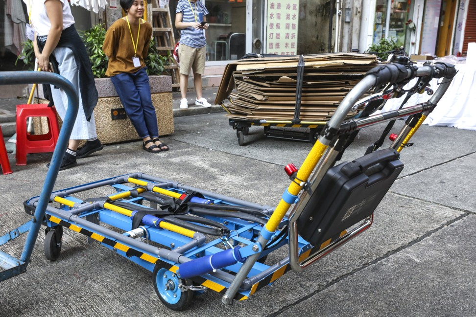 Hong Kong's cardboard nannies get trolley upgrade after team from Polytechnic University does redesign – and new ones come with a burglar alarm