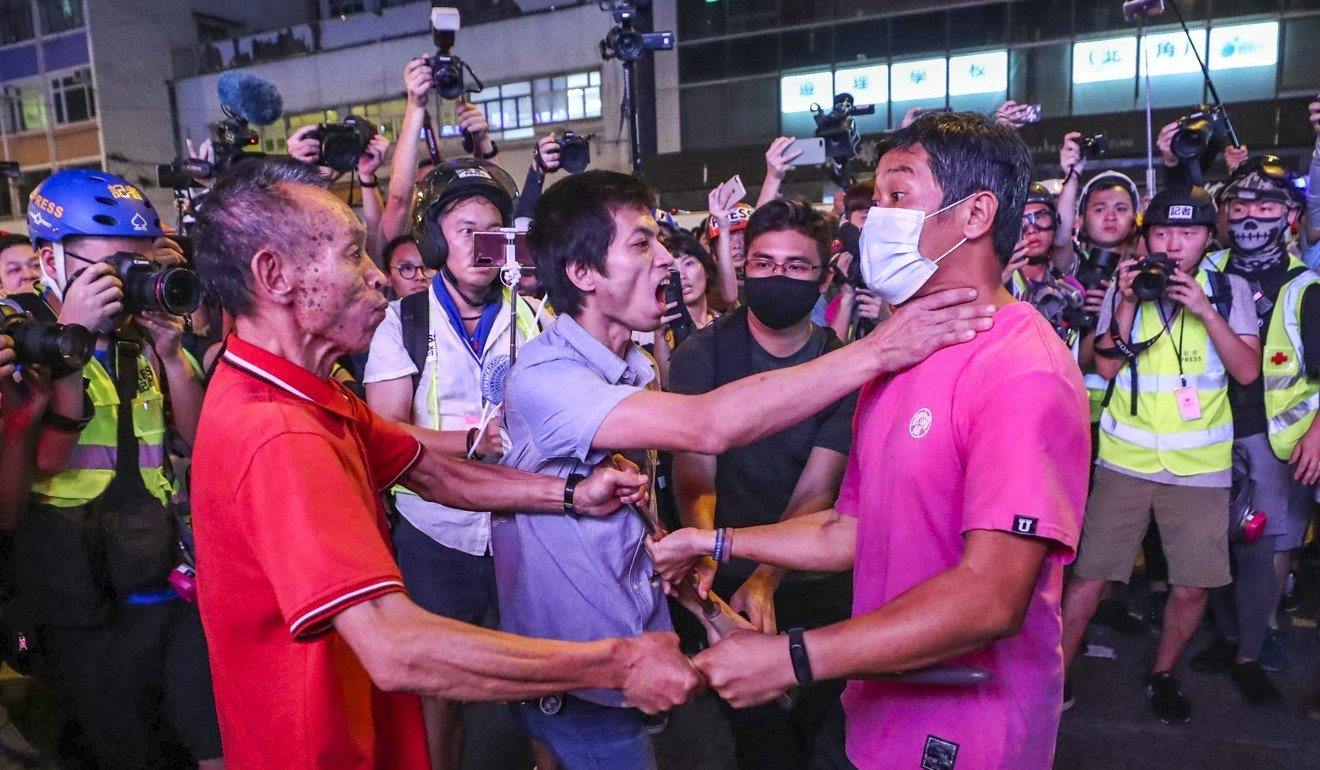 People in North Point face-off in a night of nasty scuffles and brawls. Photo: Sam Tsang