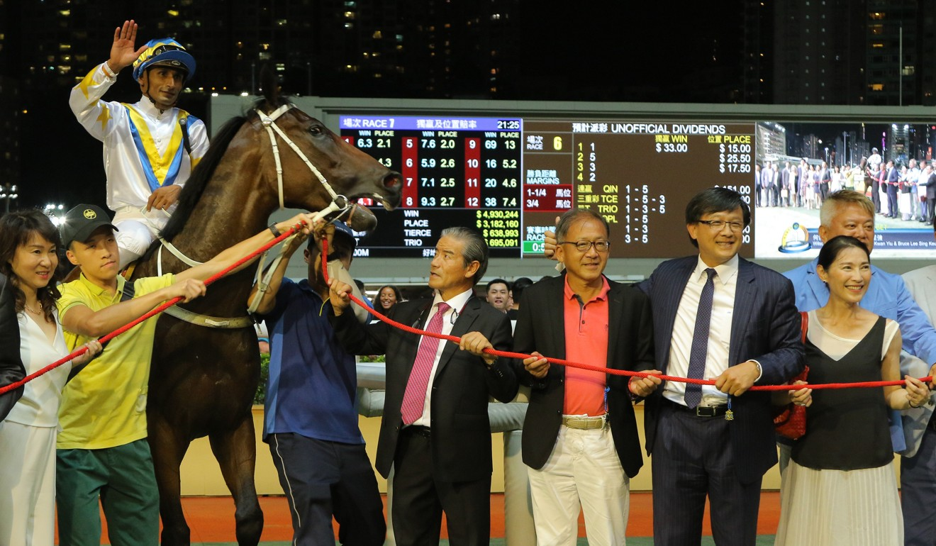 Hong Kong Bet's connections celebrate a win at Happy Valley in July. Part-owner Junius Ho is second from right.