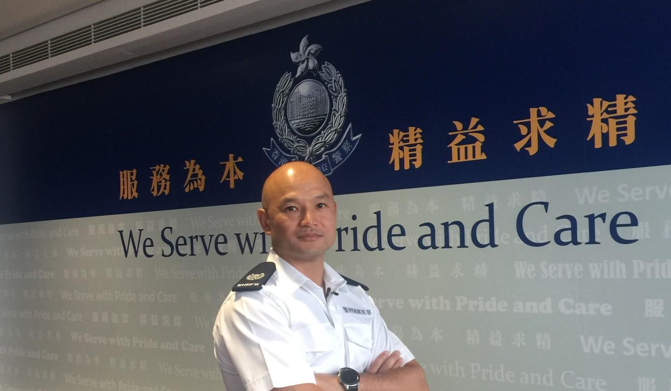 Sergeant Lau Chak-kei at police headquarters in Wan Chai. Photo: Xinhua