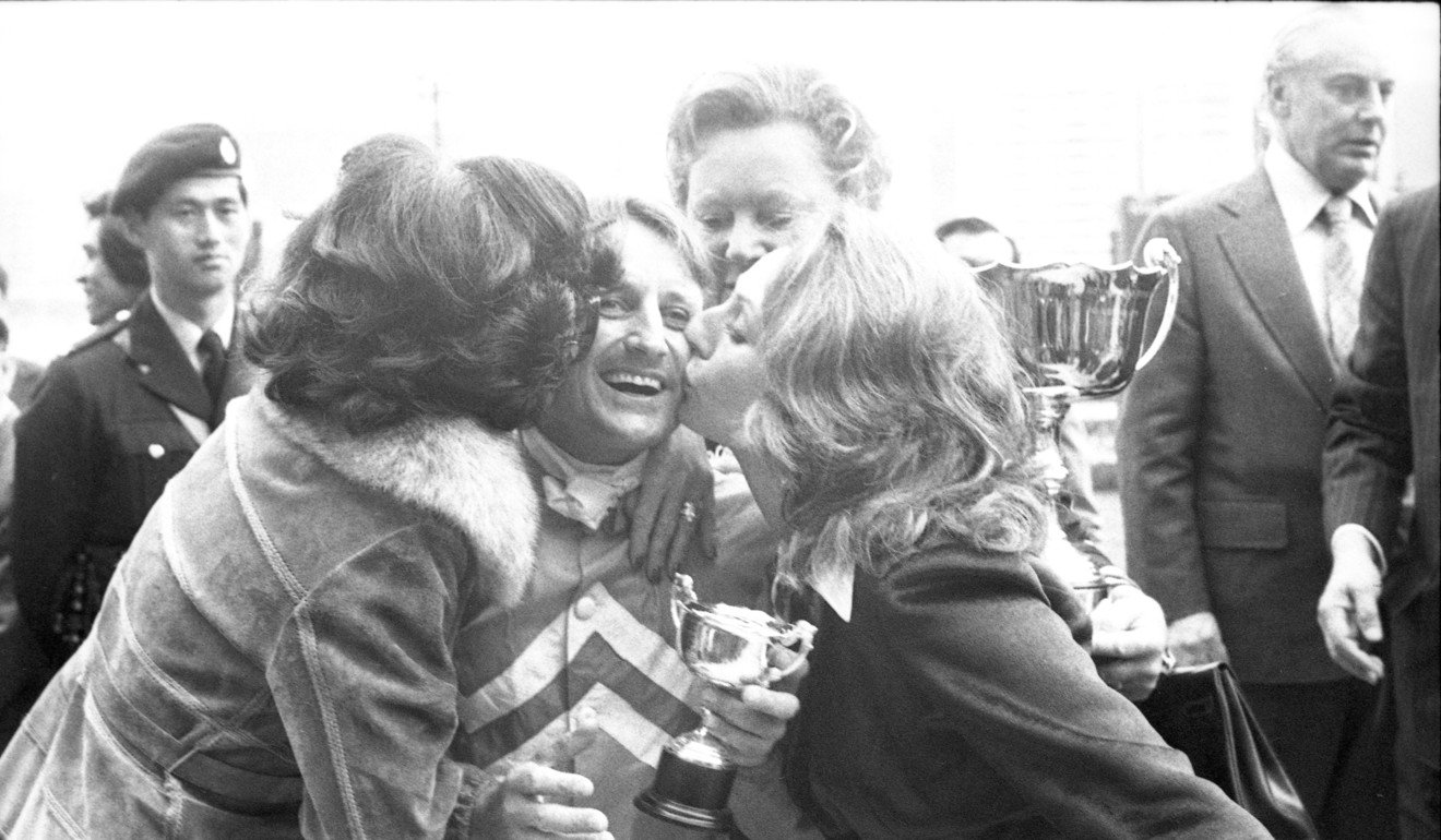 Geoff Lane is all smiles as he is kissed after winning the Po Leung Kuk Challenge Cup on Hilight at Happy Valley in 1978.