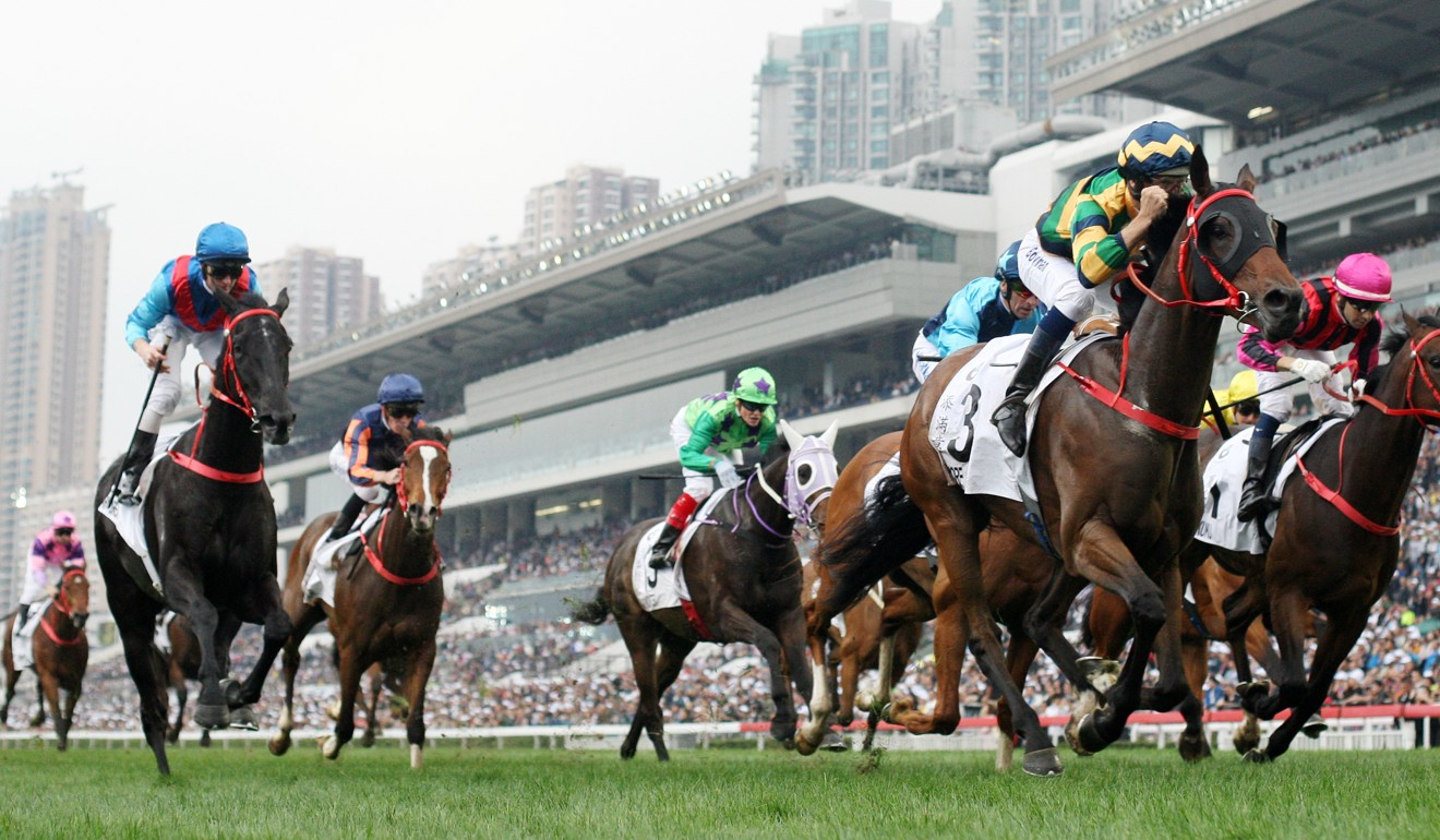 Hugh Bowman pumps his fist as Furore takes out this year's Hong Kong Derby.