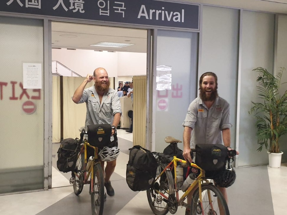 Ron Rutland and James Owens arrive in Japan, having taken a ferry from Shanghai, on their cycle from London.