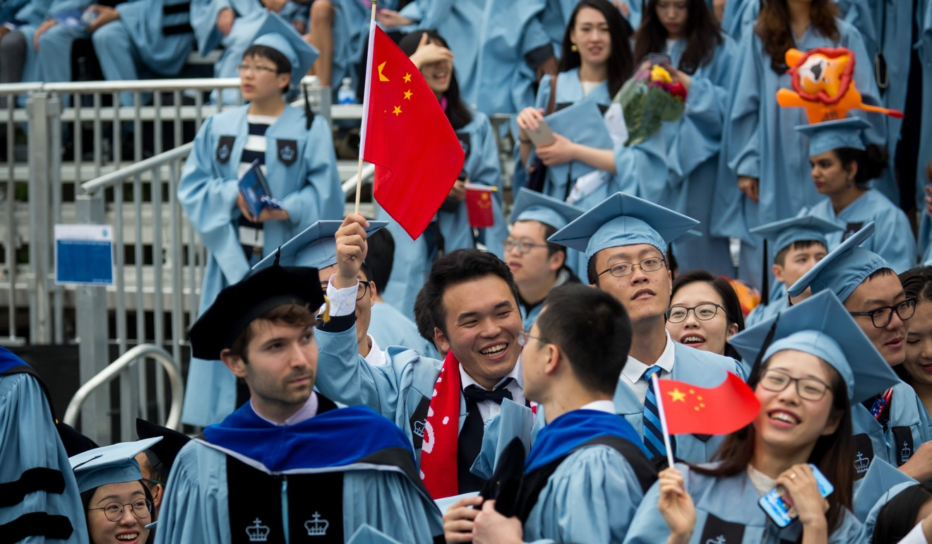 Graduates wave Chinese national flags during the commencement ceremony on May 16, 2018, at Columbia University in New York. Photo: Xinhua