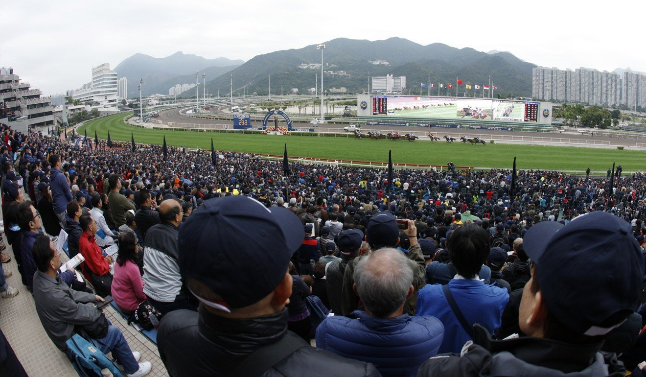 Fans watch the racing at Sha Tin.