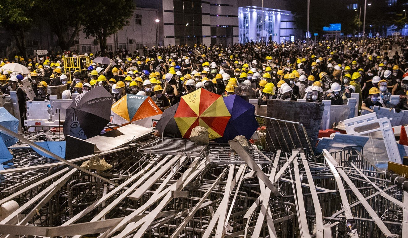 "Demonstrators gather behind a barricade as they stand off against riot police during a protest in Hong Kong on July 1. ""I support their right of expression, but I don't support what they expressed,"" one mainlander studying in the US said. Photo: Bloomberg"