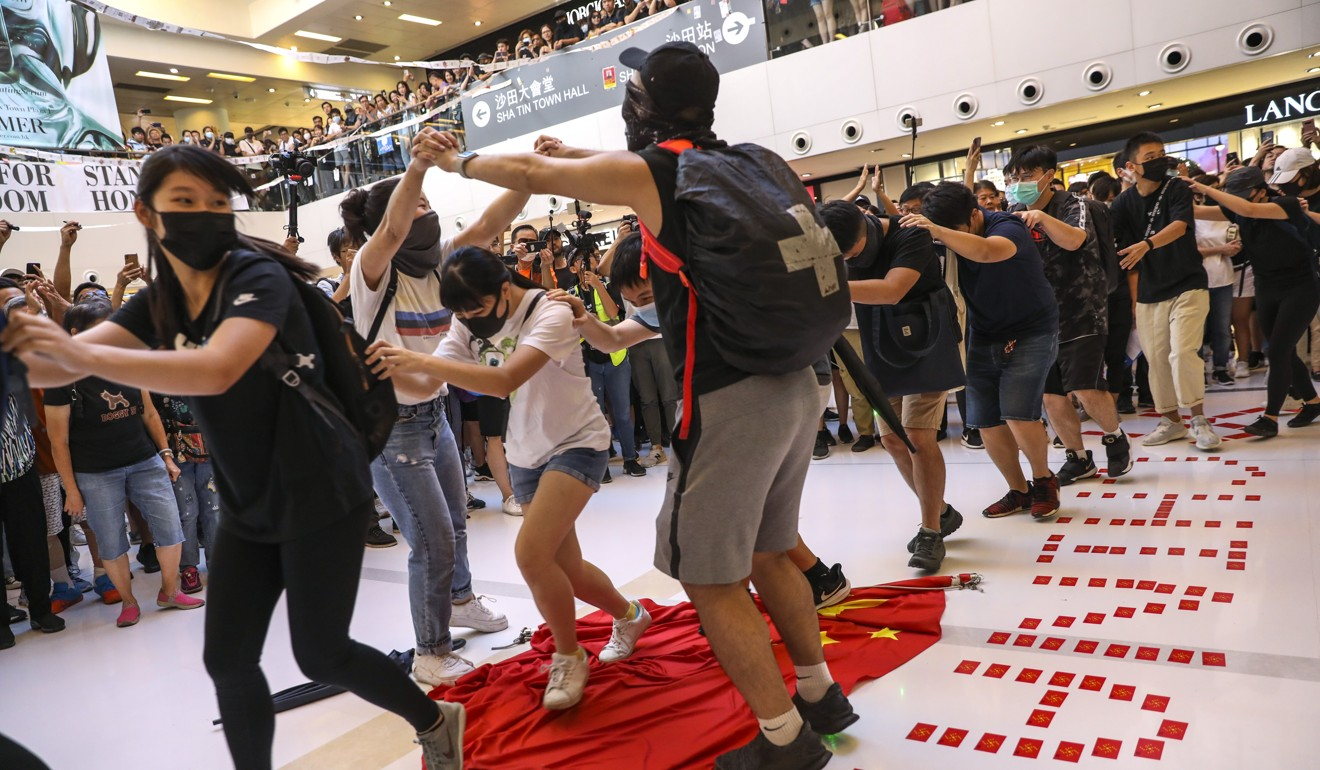 Chinese state media condemns Hong Kong protesters who desecrate national flag, calling it 'blasphemy'
