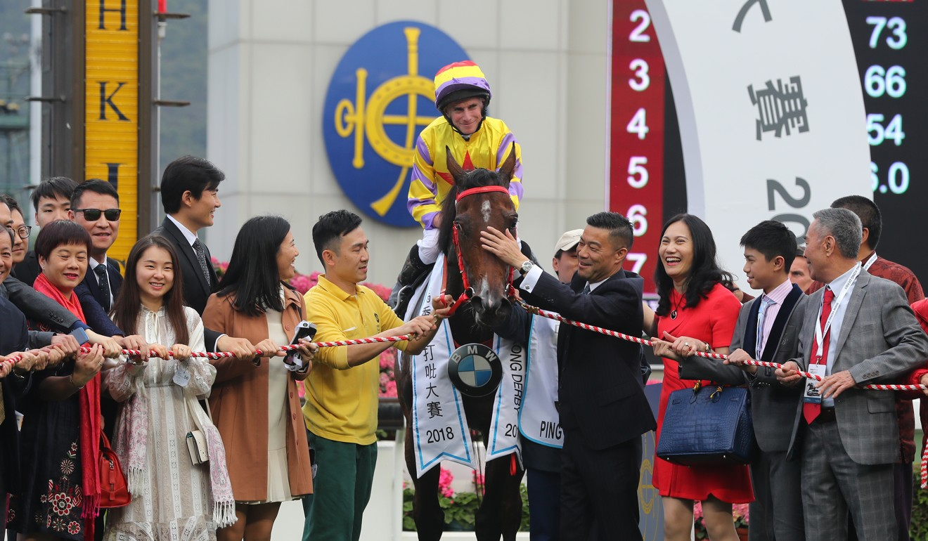 Ping Hai Star's connections celebrate the Hong Kong Derby victory.