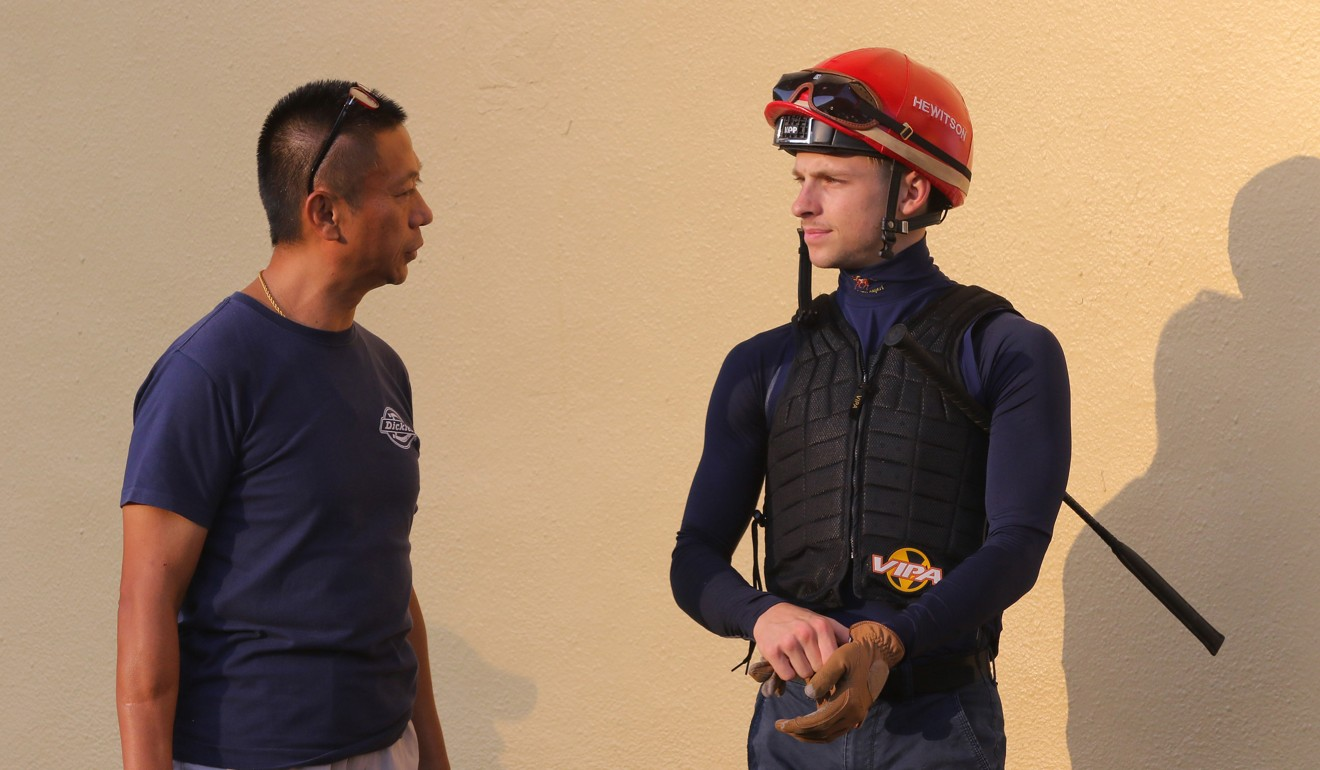 Jockey Lyle Hewitson and trainer Danny Shum chat during barrier trials at Happy Valley.