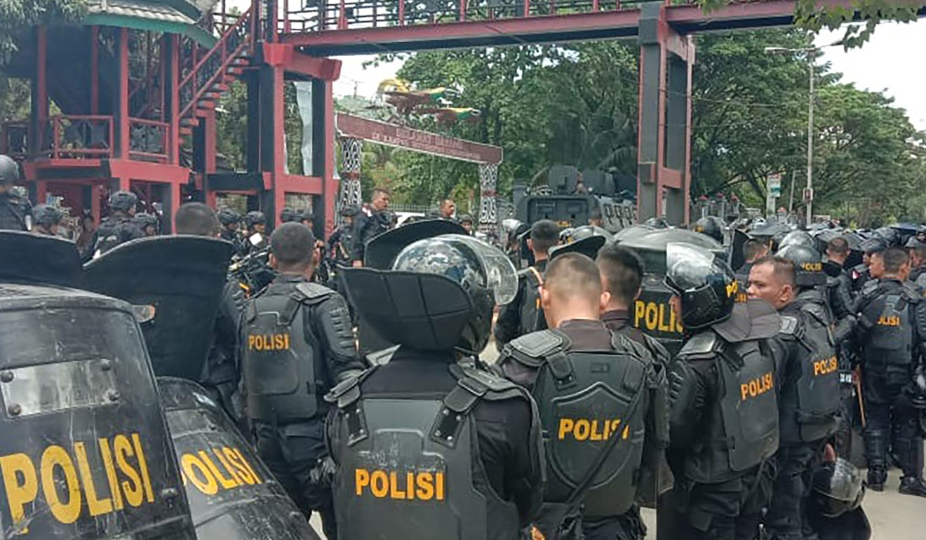Violence in Indonesia's Papua leaves at least 26 people dead after protesters clash with police