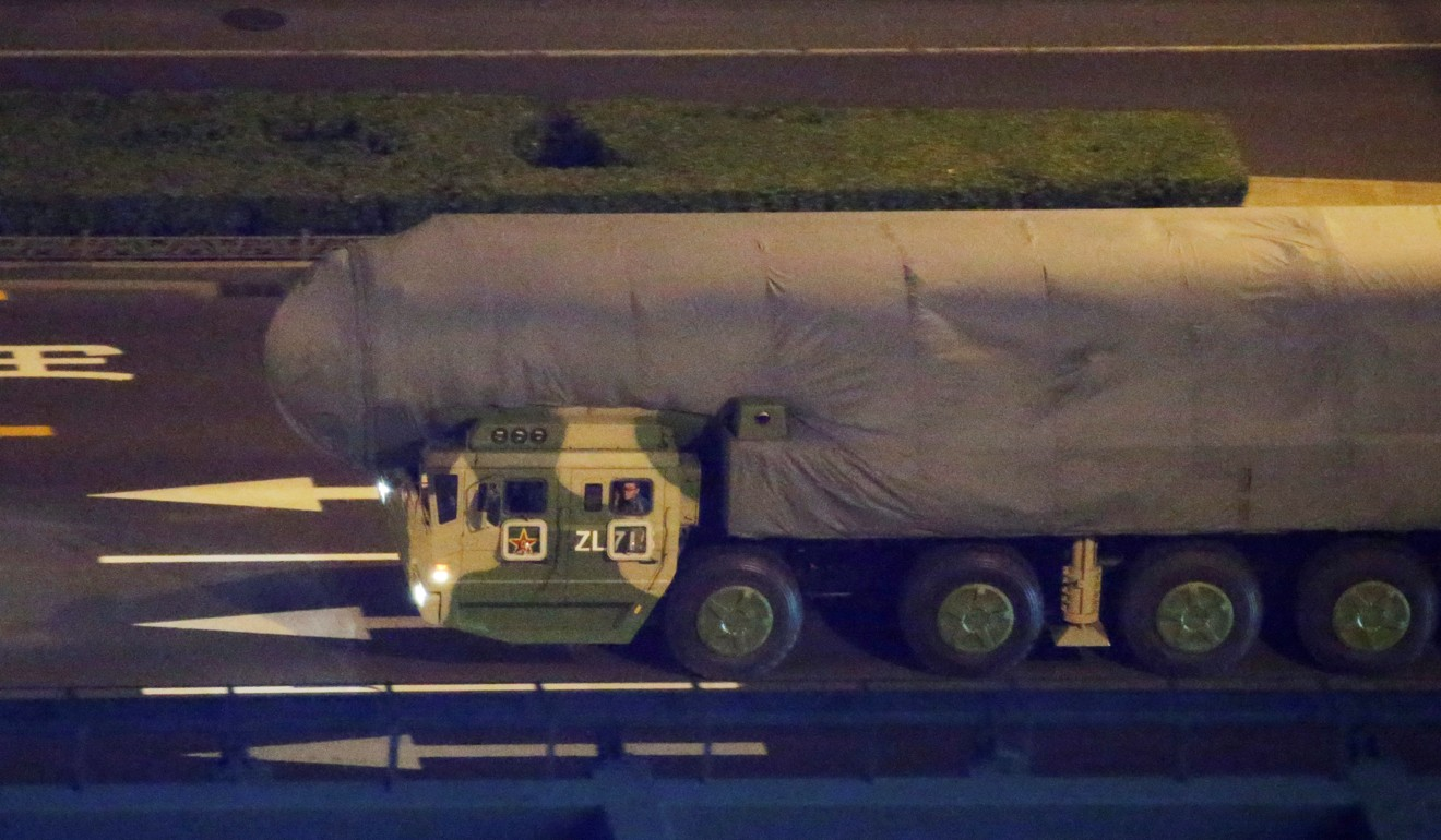 A military vehicle carrying DF-41 intercontinental ballistic missile (ICBM) travels through Beijing on September 14 in a rehearsal for the military parade. Photo: Reuters