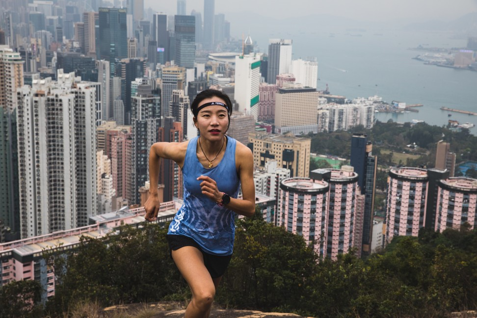 Lu Yangchun runs above Hong Kong. Photo: Adidas Terrex