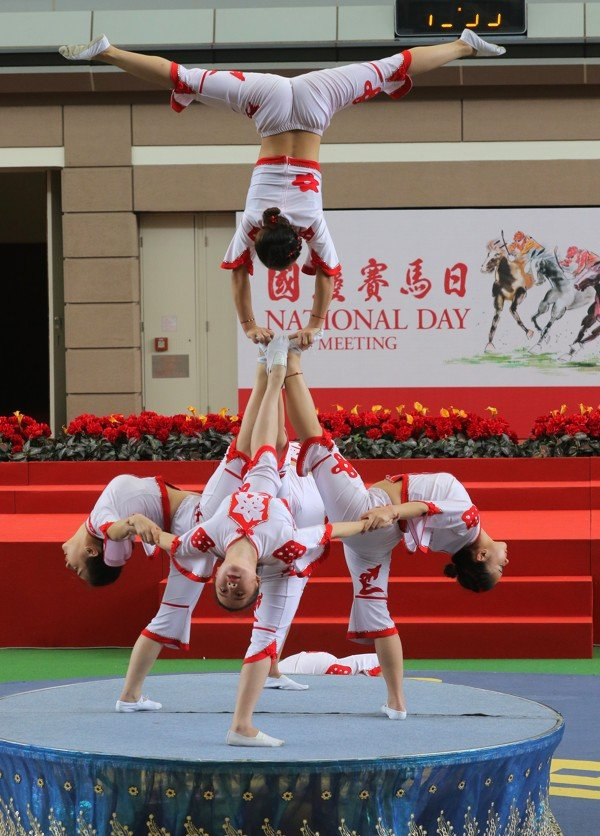 The Shenzhen Fuyong Acrobatic Troupe perform during the National Day race meeting at Sha Tin in 2018. Photo: Kenneth Chan