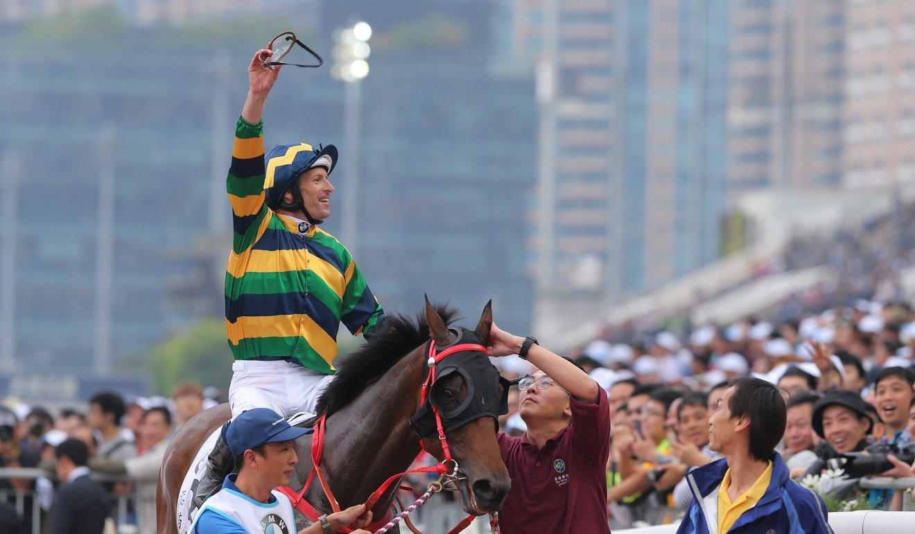 Jockey Hugh Bowman celebrates the win of Furore in the Hong Kong Derby.