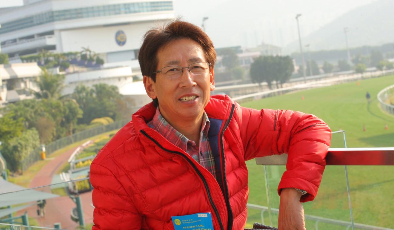 Danon Smash's trainer Takayuki Yasuda.