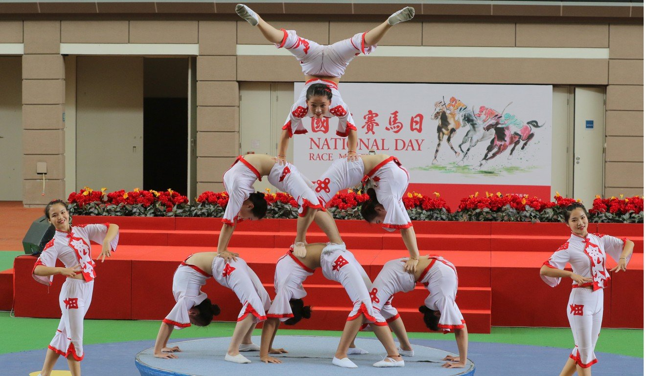 Shenzhen Fuyong Acrobatic Troupe performs during the National Day race meeting in 2018.