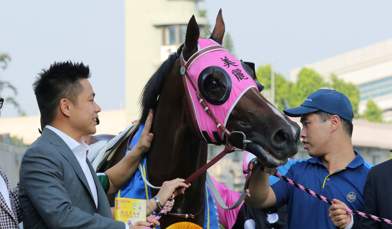 Owner Patrick Kwok looks over Beauty Generation after his win on Tuesday.