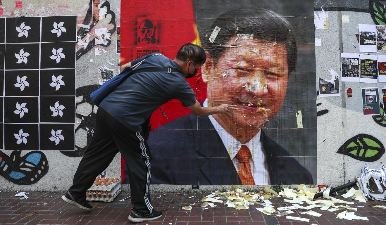 A defaced image of Chinese President Xi Jinping is seen in Hong Kong. Photo: Sam Tsang