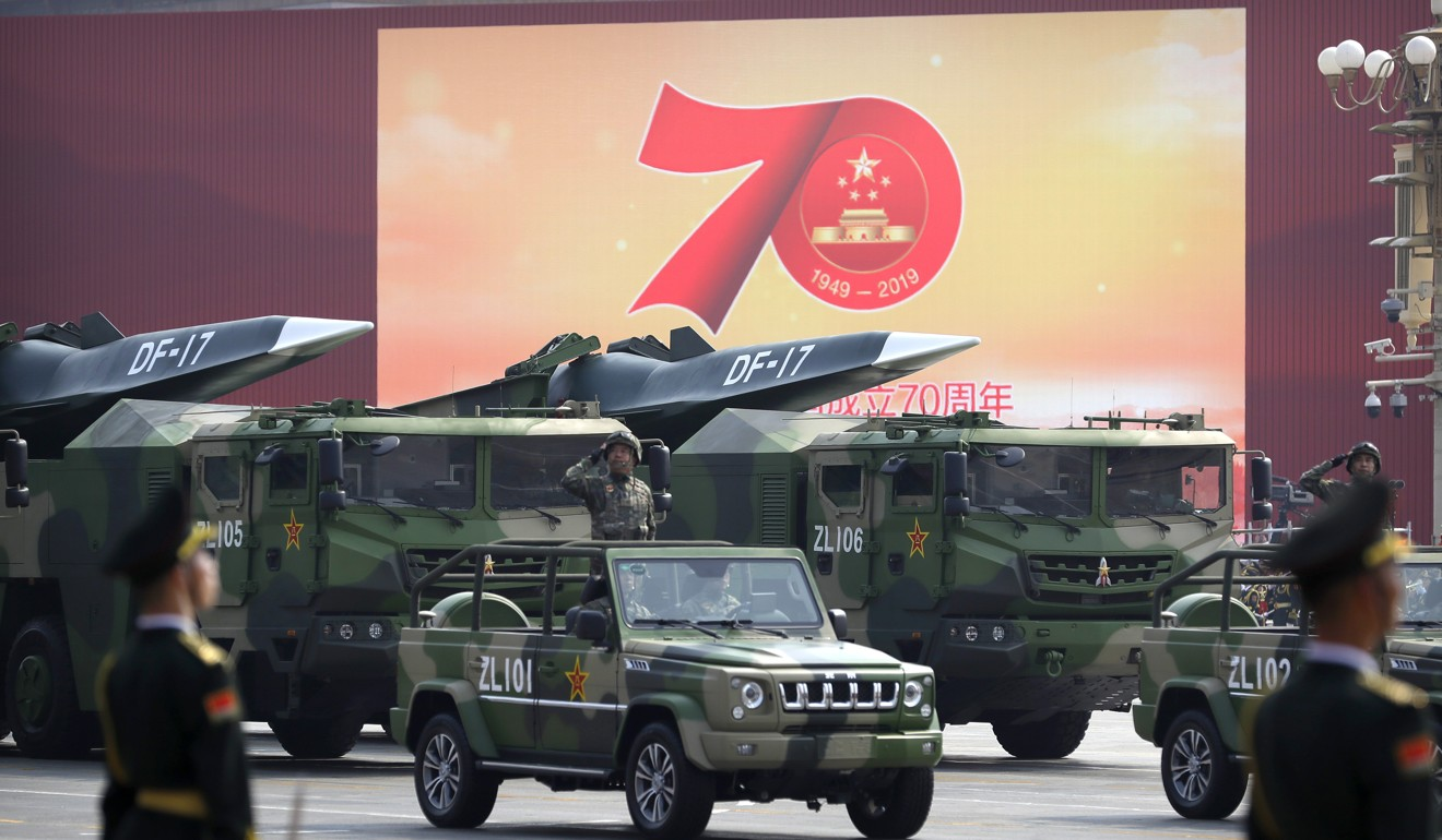 Chinese military vehicles carrying hypersonic DF-17 missiles pass through the centre of Beijing. Photo: AP