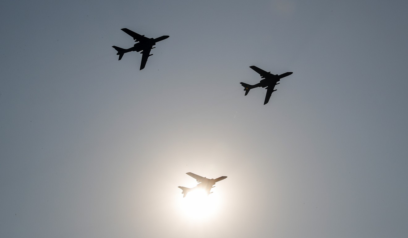 China's H-6 bomber jets fly in formation over Beijing. Photo: AP