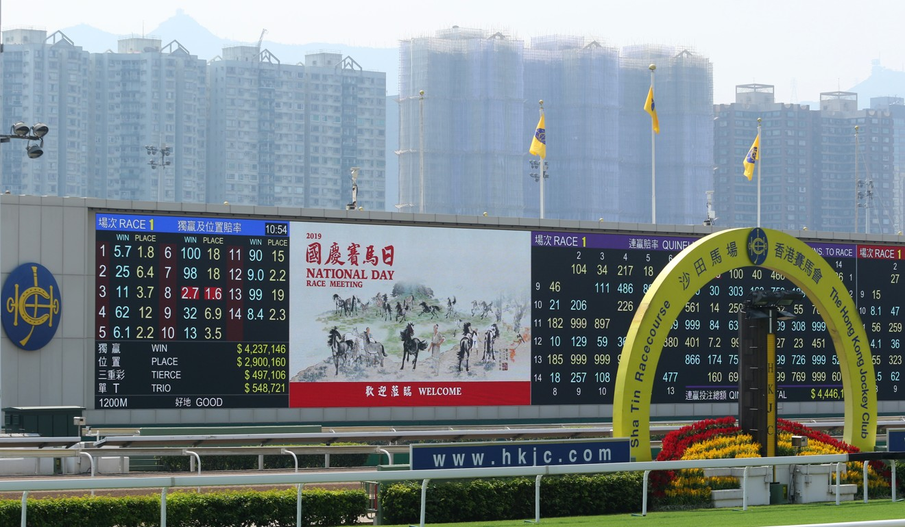 Jockey Club flags adorn the big screen at Sha Tin, replacing the flags of Hong Kong and China.